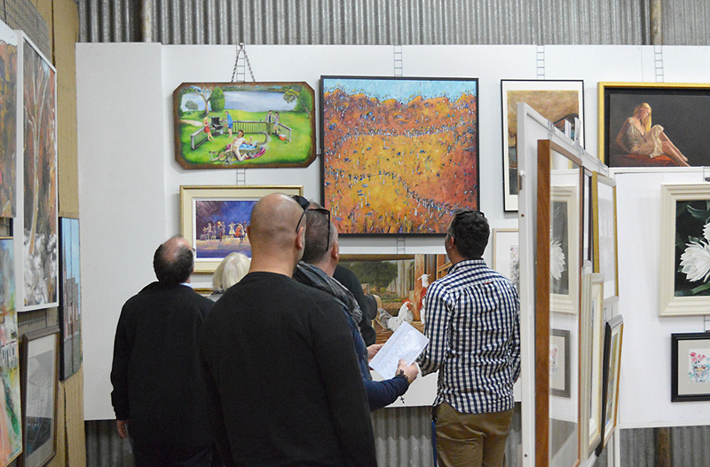Admirers of Laural's winning work at the 2014 King Valley Art Show